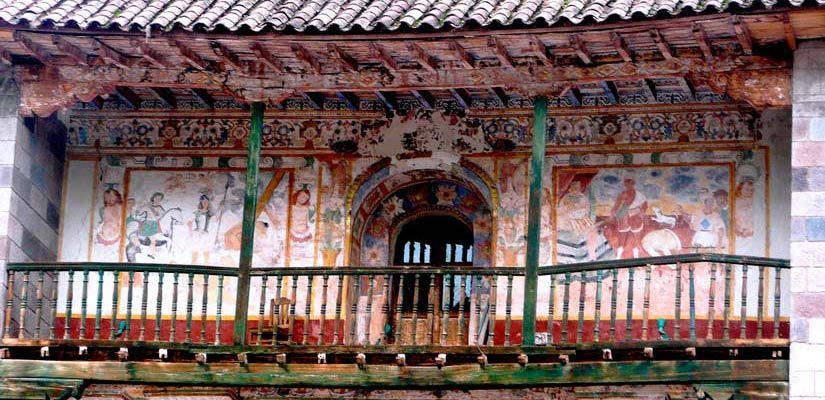 façade with paintings in the andahuaylillas chapel