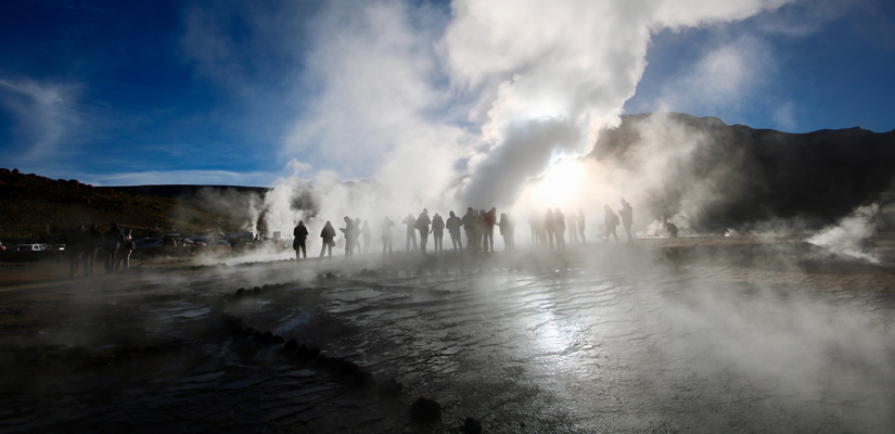 people behind tatio geyser steam in san pedro de atacama