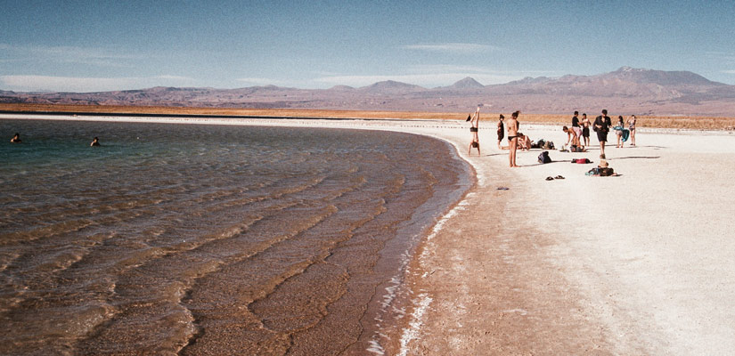 people swimming in laguna cejar in san pedro atacama
