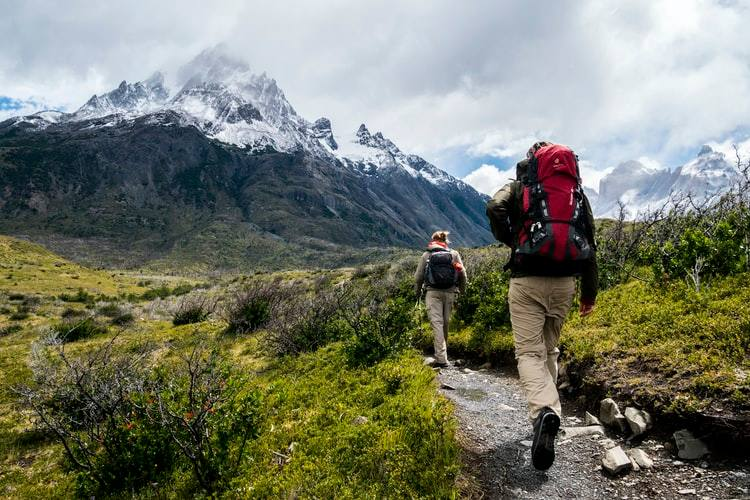 tourists trekking with backpacks