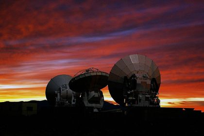 alma observatory telescopes with sunset in the background