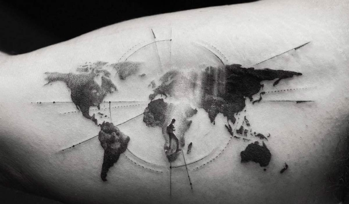 world travel tattoo on arm in black and white