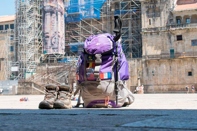 backpack in front of the cathedral of Santiago de Compostela
