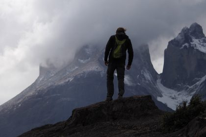person on top of the mountain in torres del paine