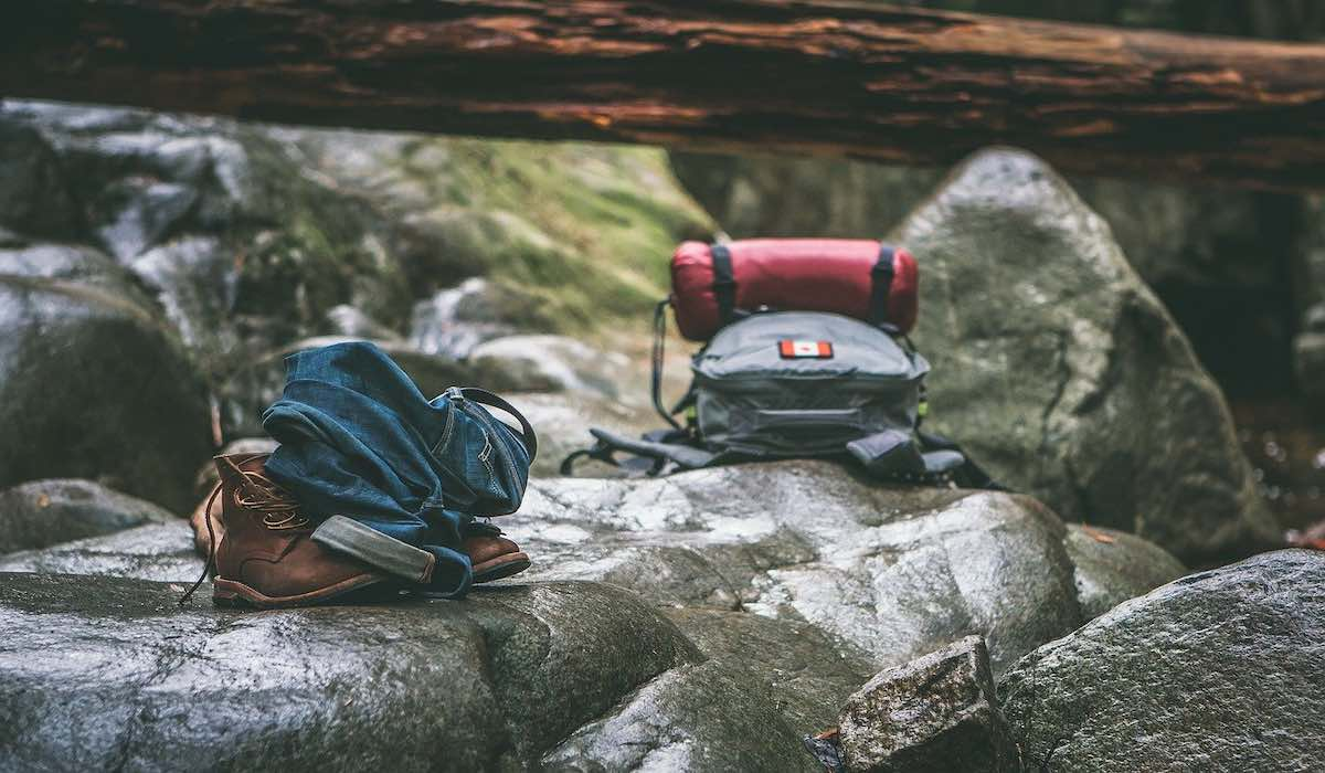 Two trekking backpacks on a rocky surface