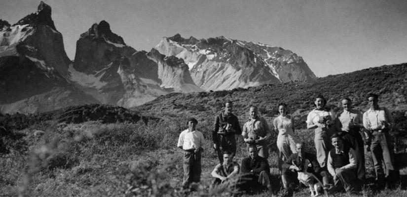 travelers in black and white in 90s in torres paine