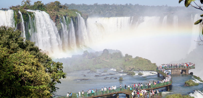 people looking from the viewpoint to the iguazu waterfalls