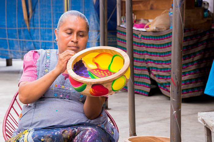 Indigenous Mexican woman making crafts