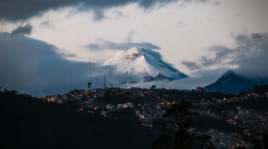 city of quito with volcano in the background