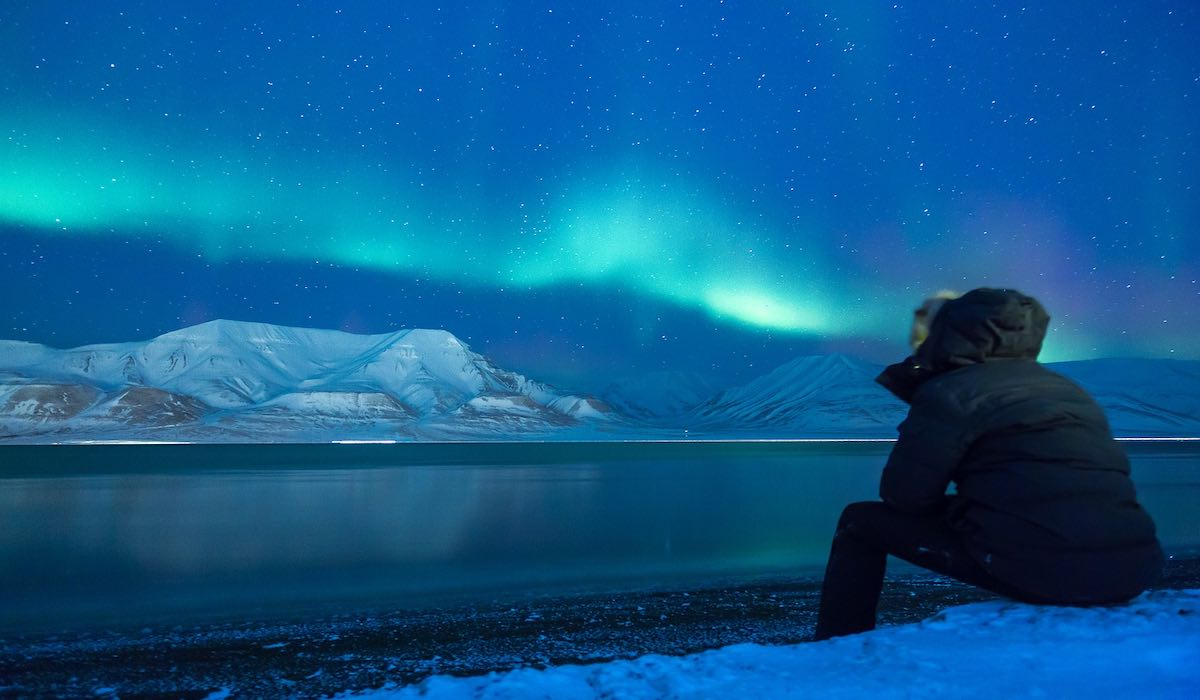 Person staring at the northern lights in Iceland
