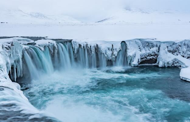 godafoss waterfall covered with ice